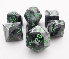 Get rolling with Gemini Dice (Black and Gray). This RPG dice set has all your...