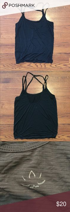 Beyond yoga black loose fitting workout top Black SUPER SOFT loose fitting strappy tank, tighter at bottom and loose throughout, low back with strappy detail, incredibly soft, beyond yoga is one the best workout clothing brands! Their stuff is so soft and lasts a long time while keeping its shape. I just never wear this one and figured I should set it free! Beyond Yoga Tops Tank Tops