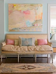 Gorgeous wall color, perfect sofa, fabulous art! House of Turquoise: Jenny Andrews