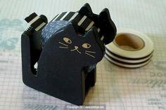 A cute black cat tape dispenser.