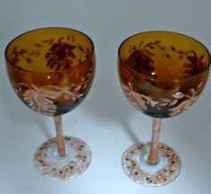 Stunning Unique amber colored small wine glasses with a light pink and copper fuchsia leaf design. Floral design on base is sprinkled with swarovski crystals