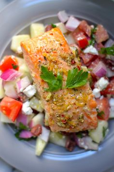 Baked Lemon and Herb Salmon with Greek Salad Salsa - this healthy 20 minute meal is so fresh and full of flavor! Sure to please the whole family!