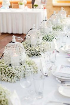 white wedding centerpiece ideas via amy and jordan photography / http://www.himisspuff.com/simple-elegant-all-white-wedding-color-ideas/