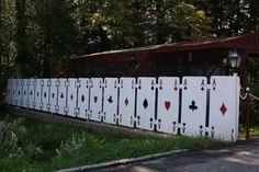 We simply love this playing card vinyl fence. If only it I was allowed to have it :)