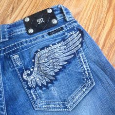 Miss Me Jeans RARE!DESIGN Miss Me Authentic Jeans Size 29.  Extremely RARE design to find!!  Wing embellishment on back pockets. Jeans have NO use or wear! NWT. Negotiable on all prices Miss Me Jeans