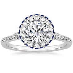 Platinum Circa Diamond Ring with Sapphire Accents from Brilliant Earth  I love this design, and love it in the round, oval, cushion and radiant settings (the setting shape changes slightly for each of these center stone options. Go check it out on their site for yourself)
