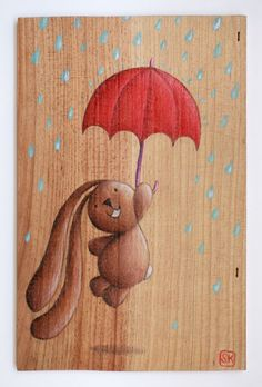 Illustration on recycled wood, bunny Ciacio and the red umbrella. Sarah Khoury 2014