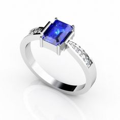 A neatly cut emerald cut tanzanite of 0.780 carats with 5 diamonds etched on each side of the band of almost 0.110 carats renders it an extremely sophisticated appearance. The violetish blue radiance of the tanzanite when blended with subtle white shine of gold alters the ambience and makes it look more divine and artistic. It can go well with almost every kind of attire making it look more graceful.
