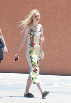 Elle Fanning wearing a fruity dress out in L.A. See all of the actress's best looks.