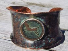 jewelry image of Anticlastic formed copper cuff bracelet, with ancient Sicilian bronze coin (400 BC) set in fine silver