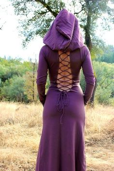 This elvish dress has an extra big hood that will make you feel feminine and mysterious. The back is deeply open with lace-up detail.