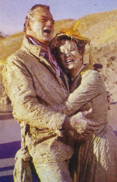 John Wayne and Maureen O'Hara.  The funniest moment of Mclintock!