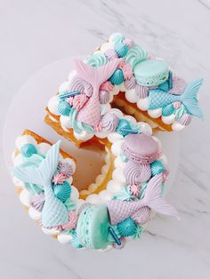 Planning a themed mermaid birthday party and don't know what to serve? Inspire yourself with these 19 mermaid birthday party food ideas kids will love! Number Birthday Cakes, 5th Birthday Cake, Mermaid Birthday Cakes, Barbie Birthday Party, Number Cakes, Birthday Ideas, Mermaid Cookies, Mermaid Cupcakes, Underwater Birthday