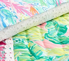 Summer dreams start with this Lilly Pulitzer Party Patchwork Quilt in fun tropical-inspired prints. Sky blues, botanical greens and pops of orchid pink mix with lots of texture to bring Lilly's iconic style their room. Imagined exclusively f…