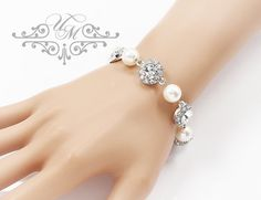 "Handmade Swarovski Pearl Swarovski Crystal Rhinestone Bracelet / Wedding Bracelet / Bracelet is 8"" long + 2.5"" extender. Bracelet Weight : 30g Rhinestone ornament : 14mm Platinum plated 100% Brand New / https://www.etsy.com/listing/195916783/wedding-jewelry-swarovski-pearl-bracelet"
