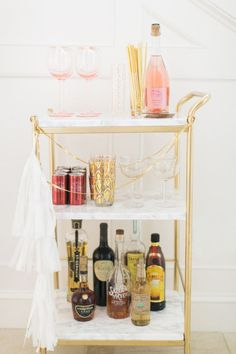 Ikea Hack: DIY Mini Bar Cart Read More: https://www.stylemepretty.com/living/2015/12/29/ikea-hack-diy-mini-bar-cart/