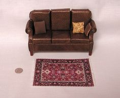 "Traditional brown ""leather"" sofa & 3 throw pillows, bronze circle ornaments. 1 to 12 dollhouse scale miniature.  Made in the USA."