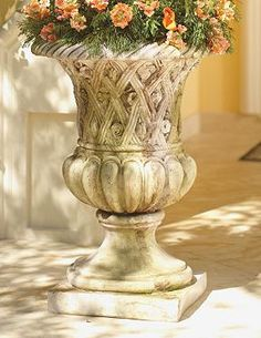 Add a touch of regal elegance to your outdoor space while prominently displaying your favorite florals with the Lucio Outdoor Planter.