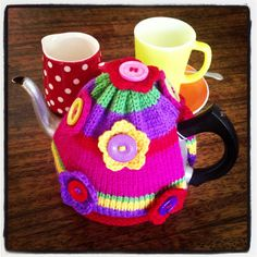 Sunshine & rainbows tea cosy by Lauren Bittner. What a punch of colour!