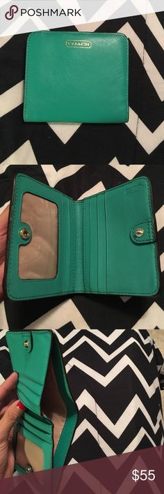Small  leather coach wallet Lightly used in good condition. Plenty of room for cards and small essentials. Coach Accessories Key & Card Holders