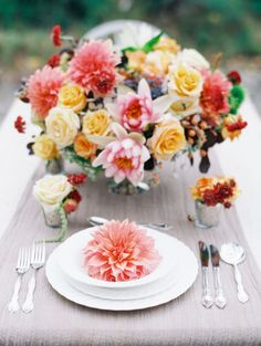Bright flowers galore: http://www.stylemepretty.com/australia-weddings/2015/04/07/exotic-australian-bayside-wedding-inspiration/   Photography: Mark Potter - http://www.markpotterphotography.com/