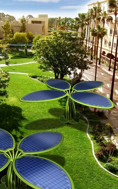 * A solar tree for a park. Using energy from the sun. It something cool to look at having power for the park. It looks like at tree and helps the environment.