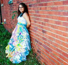 """Three weeks after her wedding to husband Brad Gruenwald, Laura made a mess of her dress as well as her hands. It was too cold in October to wear her dress into a creek or swimming pool, so she opted to """"trash"""" her wedding dress using acrylic paints."""