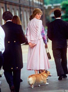 a corgi following Diana, who's following Queen Elizabeth ~
