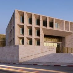AAU Anastas completes Palestinian courthouse featuring stone walls and golden latticework