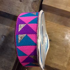 Ethnic ribbon of graphic inspiration, blue pink and purple
