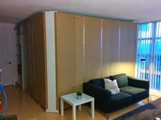 Room inside a room. Constructed with IKEA pax wardrobes. This is the work in progress. Click to see the cool end result.