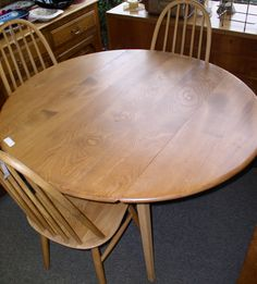 Mid-Century drop-leaf dining table & chairs $950
