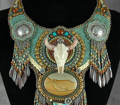 I Should Have Been a Cowgirl just got back from Milwaukee, Wisconsin where it was a finalist in the International beading competition BeadDreams. It features a resin steer skull, some incredible cabochons of picture jasper and Nevada boulder turquoise. and 2 vintage sterling silver scarf slides. Accents of braided deer skin. fringe, amber and silver add to the western look. It is meant be worn as a collar and has a circumference of about 15 1/2 to 16 inches. It measures about 7 inches in...