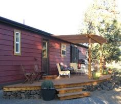 Curved deck and pergola make a unique entry for this double wide mobile home. Lot's of inspiration here!