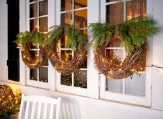 Outdoor Christmas Decorating Ideas : Hang grapevine wreaths in each of your front windows to recreate this outdoor holiday decor with simple charm. Best Outdoor Christmas Decorations, Christmas Greenery, Christmas Porch, Simple Christmas, Christmas Lights, Outdoor Ideas, Christmas Wreaths In Windows, Outdoor Lighted Christmas Decorations, Outdoor Xmas Lights