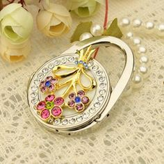 Wedding Favors - $9.79 - Floral Flower Design Chrome Purse Valets With Rhinestone  http://www.dressfirst.com/Floral-Flower-Design-Chrome-Purse-Valets-With-Rhinestone-051032178-g32178