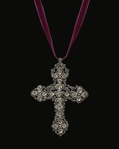 Diamond cross pendant by Lydia Courteille.