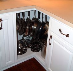 Fill awkward corner cabinets with pots and pans using hooks or lazy susans. 10 Clever Kitchen Lifehacks