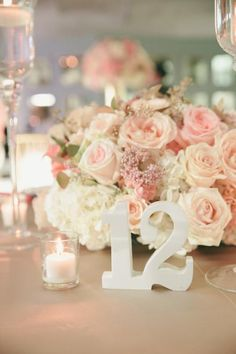 Pasadena,+California-based+Skybox+Event+Productions+placed+votives+near+blush-colored+rose+centerpieces+to+cast+a+warm+glow.