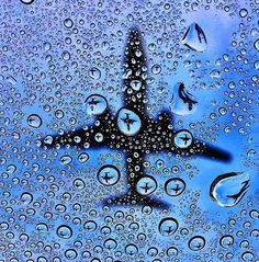 Cool Photo of a Plane Passing Behind Window Condensation