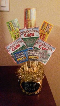 Pot of gold lottery ticket bouquet. Gift idea Fill bottom with golden candies like Chocolate coins if you can find them, or Werthers, or Hersheys