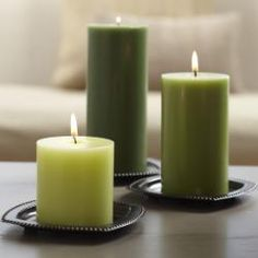 """Bronze Candle Holder Trio - Spread out this traditional trio to create a timeless candle display. Rounded metal with a shiny lacquer finish. For use with round or square pillars, Escential jar or GloLite by PartyLite® jar, all sold separately. For use with round or square pillars, Escential jars, GloLite jars, tealights, or large tealights all sold separately. 5"""" square."""