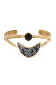 """With this cuff, hovering moons rest effortlessly on top of the wrist. Stack it with other bracelets to create your own witchy look. Dimensions: Measures 2.25"""" in diameter. Moon measures approximately"""