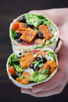 This easy 30-min sweet potato black bean burrito recipe will be a new staple in your house! Loaded with all the fixings and tons of flavor! Vegan.