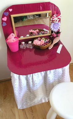 One box and two pieces of cardboard = hours of fun in the form of a play dressing table or hair salon