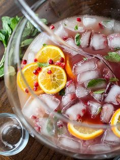 Pomegranate and Orange Champagne Punch is a fancy looking but totally easy punch for a crowd. | foodiecrush.com