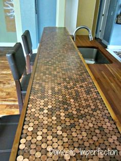 A work top made with pennies - got to do this.  Looks like the best way is to edge to top with wood, cover with pennies, then cover with polyurethane varnish?).  Just got to do