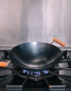 We've all dealt with terrible messes from food sticking to a pan or wok. This easy tip is our secret for how to keep food from sticking, without fail! Fried Spinach, Carbon Steel Wok, Searing Meat, Best Wok, Raw Protein, Pan Fried Fish, Wok Of Life, Stainless Steel Pans, Cook Off