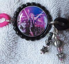 http://www.ebay.com/itm/Ladeda4u-Gina-AVRIL-LAVIGNE-BRACELET-/271290288571?pt=US_Charm_Charm_Bracelets&hash=item3f2a2949bb