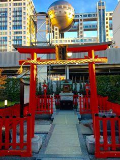Photo by Gail Nakada. Little Odaiba Jinja shrine with Fuji TV building in the background.